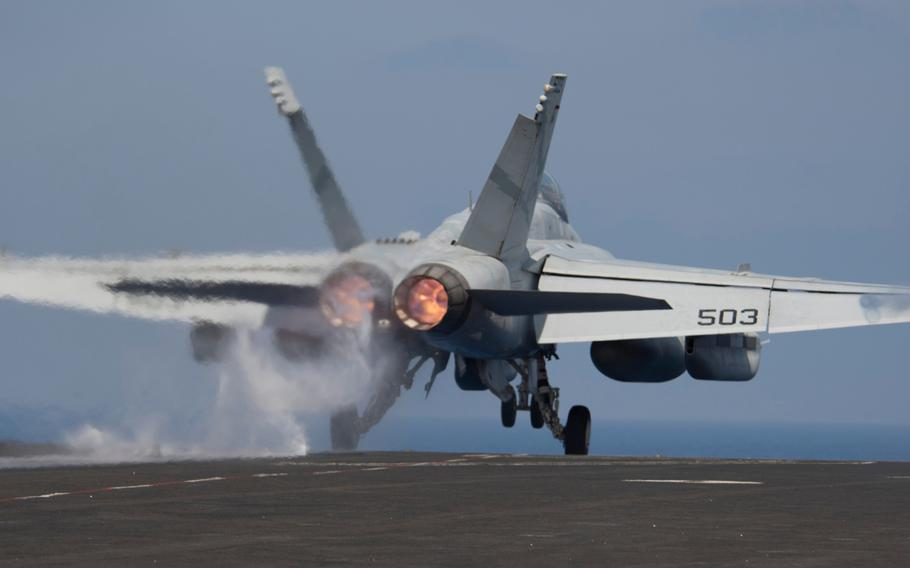 """An EA-18G Growler, attached to the """"Lancers"""" of Electronic Attack Squadron 131, launches from the flight deck of the Nimitz-class aircraft carrier USS George H.W. Bush to conduct flight operations in support of Operation Inherent Resolve on June 6, 2017."""