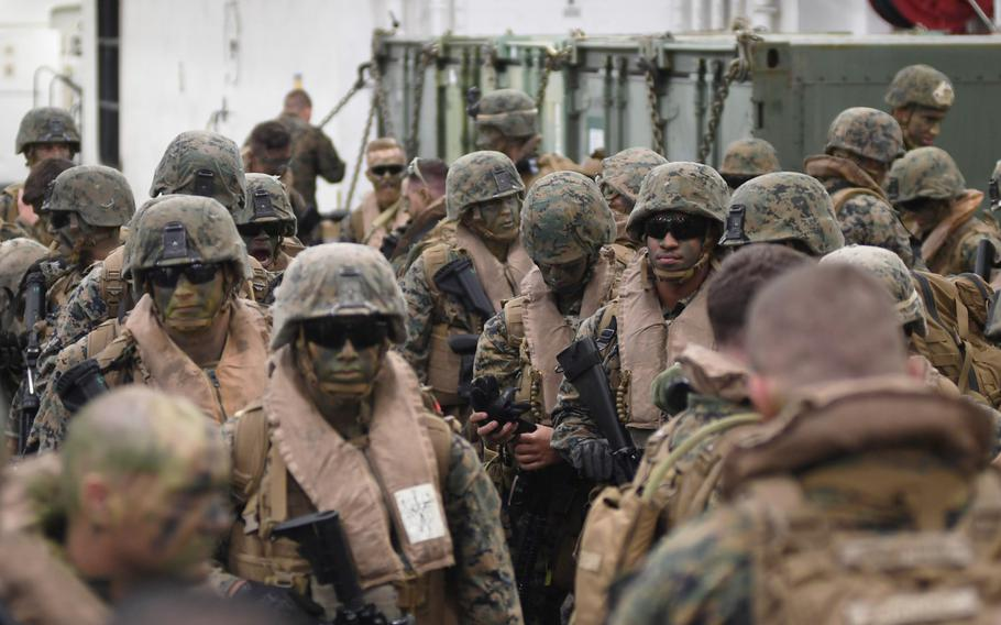 U.S. Marines prepare to load into assault amphibious vehicles during a beach landing in Ventspils, Latvia, as part of exercise BALTOPS, a U.S.-led multinational maritime exercise in the Baltic Sea region.