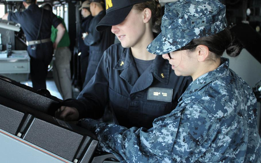 Midshipman 1st Class Nicole Busa ( left) and Midshipman 3rd Class Kendall Zotti do bridge watch training aboard the USS Arlington during BALTOPS, a U.S.-led multinational maritime exercise in the Baltic Sea region.