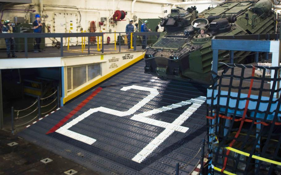 An assault amphibious vehicle enters the well deck of the USS Arlington on June 6, 2017 to prepare for a simulated amphibious assault during BALTOPS, a U.S.-led multinational maritime exercise in the Baltic Sea region in which 14 countries participated.