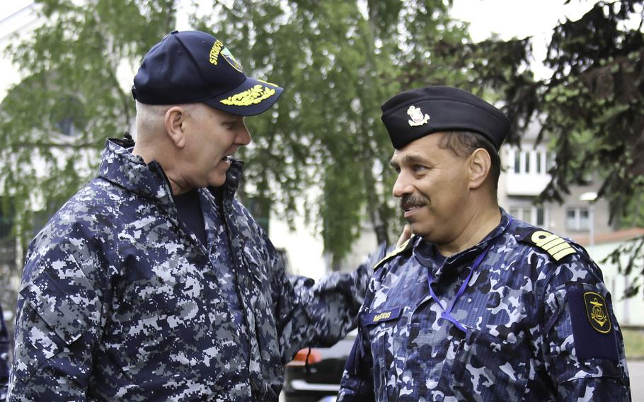 Vice Adm. Christopher Grady, 6th Fleet commander,  greets Capt. Arunas Mockus, commander in chief of the Lithuanian Navy, on during exercise BALTOPS on June 5, 2017. BALTOPS is an annual U.S.-led multinational maritime exercise in the Baltic Sea region.