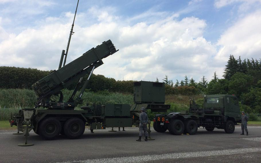 First Air Defense Missile Group personnel demonstrate a PAC3 launcher at Iruma Air Base, Japan, Friday, June 9, 2017.