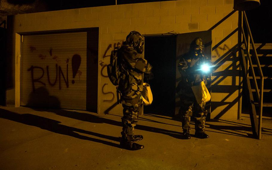 A pair of soldiers from the 23rd Chemical Battalion search for simulated chemical weapons at the underground training facility on Camp Stanley, South Korea, Tuesday, May 23, 2017.