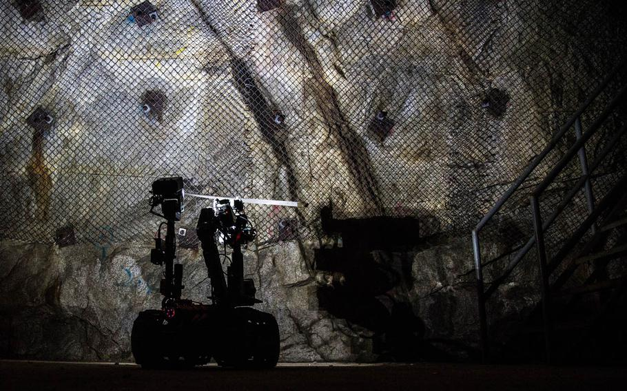 A chemical-sniffing robot investigates a site at the underground training facility at Camp Stanley, South Korea, Tuesday, May 23, 2017.