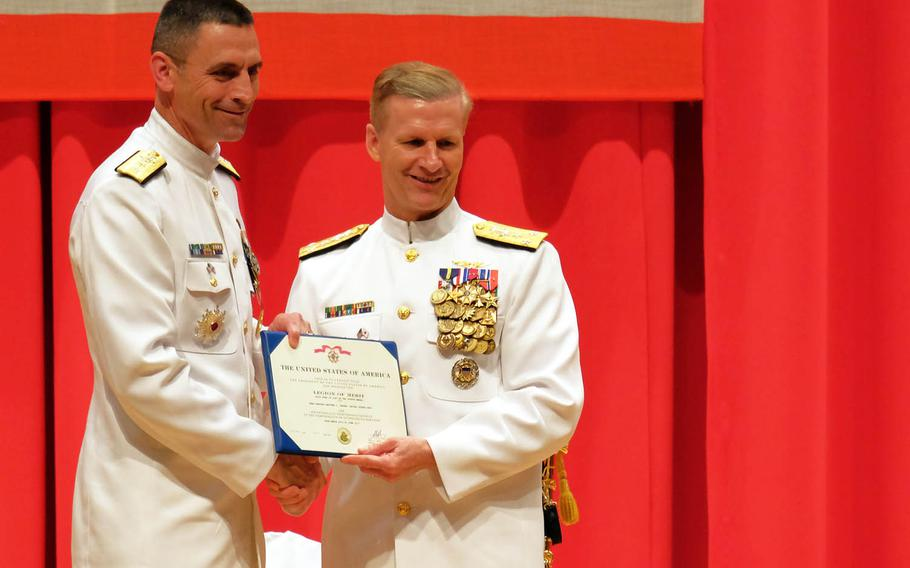 Outgoing Naval Forces Japan Commander Rear Adm. Matthew Carter, left, receives the Legion of Merit award from 7th Fleet Commander Vice. Adm. Joseph Aucoin during a change-of-command ceremony at Yokosuka Naval Base, Japan, Friday, June 16, 2017.