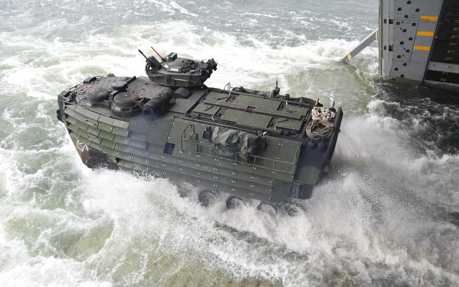 An assault amphibious vehicle departs the well deck of the amphibious transport dock ship USS Arlington for a beach landing training evolution in Ustka, Poland, during exercise BALTOPS 2017, Wednesday, June 14, 2017.   .