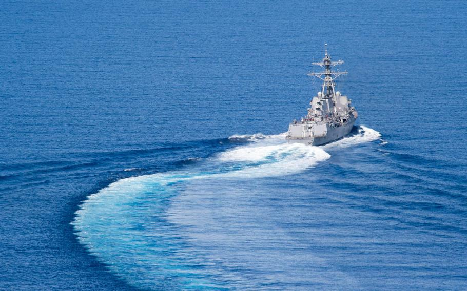 The guided-missile destroyer USS Dewey transits the South China Sea in May.