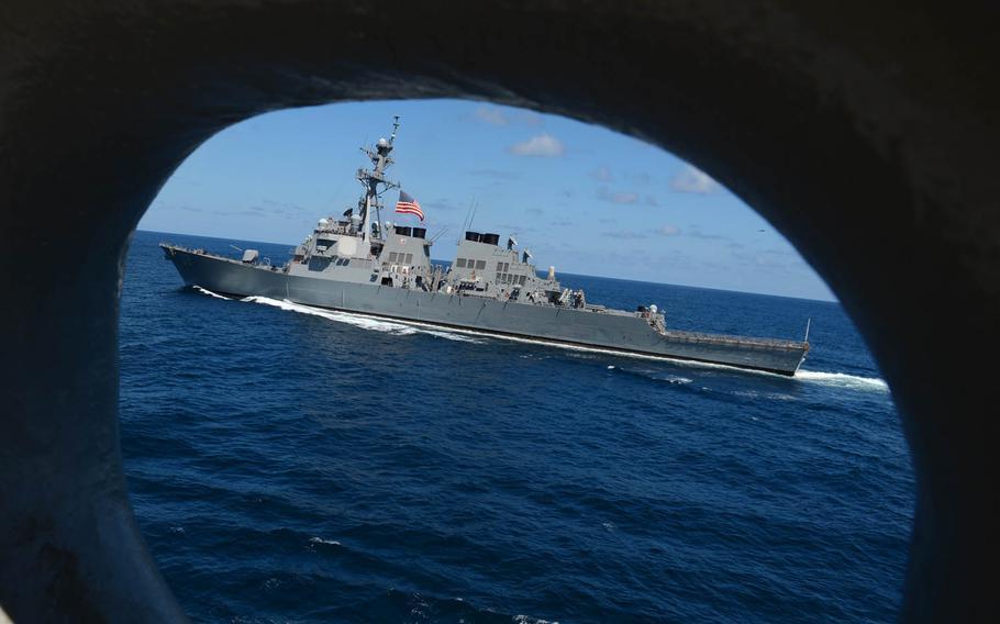 The destroyer USS Fitzgerald pulls alongside amphibious assault ship USS Bonhomme Richard as it transits the Pacific Ocean.