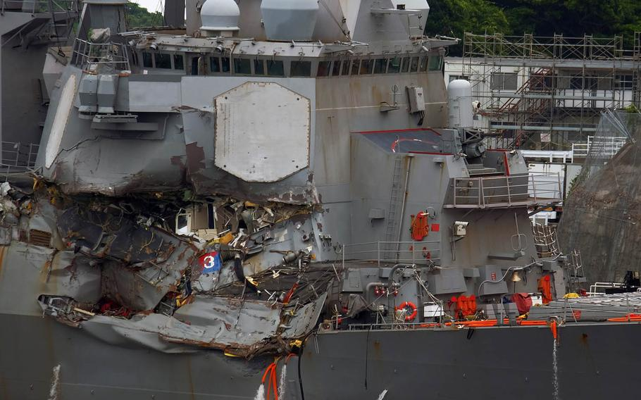 The Navy destroyer USS Fitzgerald, which was involved in an early Saturday collision with a merchant ship, is seen at Yokosuka Naval Base, Japan, Sunday, June 17, 2017.