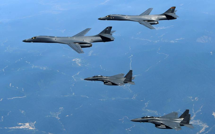 Two Air Force B-1B Lancers assigned to the 9th Expeditionary Bomb Squadron, deployed to Guam from Dyess Air Force Base, Texas, fly with two South Korean F-15s near the Korean Peninsula, Tuesday, June 20, 2017.