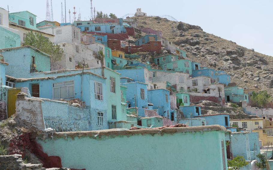 Newly-painted homes on  Kabul's TV Mountain stand in the sunlight on June 19, 2017. They are some of the 2,000 houses that have been painted as part of a new initiative that aims to improve residents' mental health.