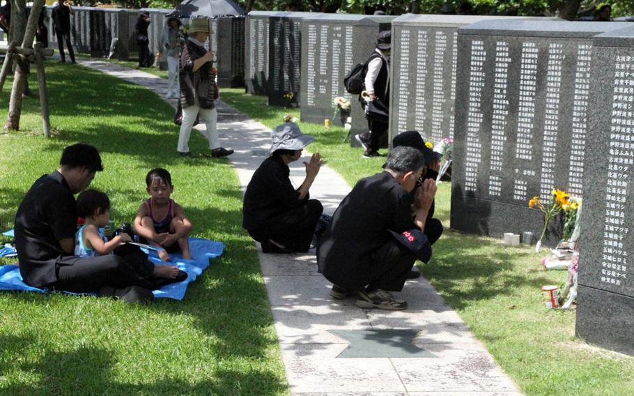 Okinawans mourn for lost relatives during the Irei no Hi ceremony at Okinawa Peace Memorial Park in Naha, Okinawa, Friday, June 23, 2017.
