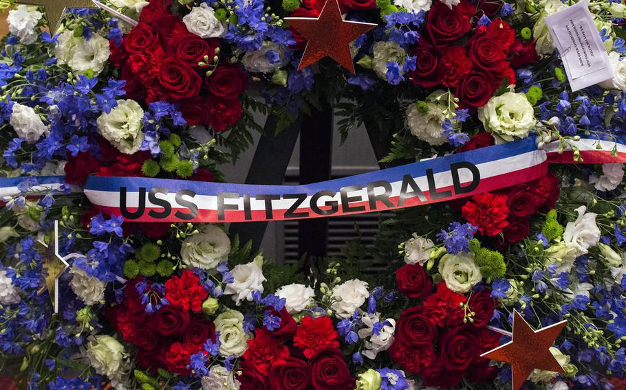 Family, friends and shipmates attend a memorial ceremony for seven USS Fitzgerald sailors at Yokosuka Naval Base, Japan, Tuesday, June 27, 2017.