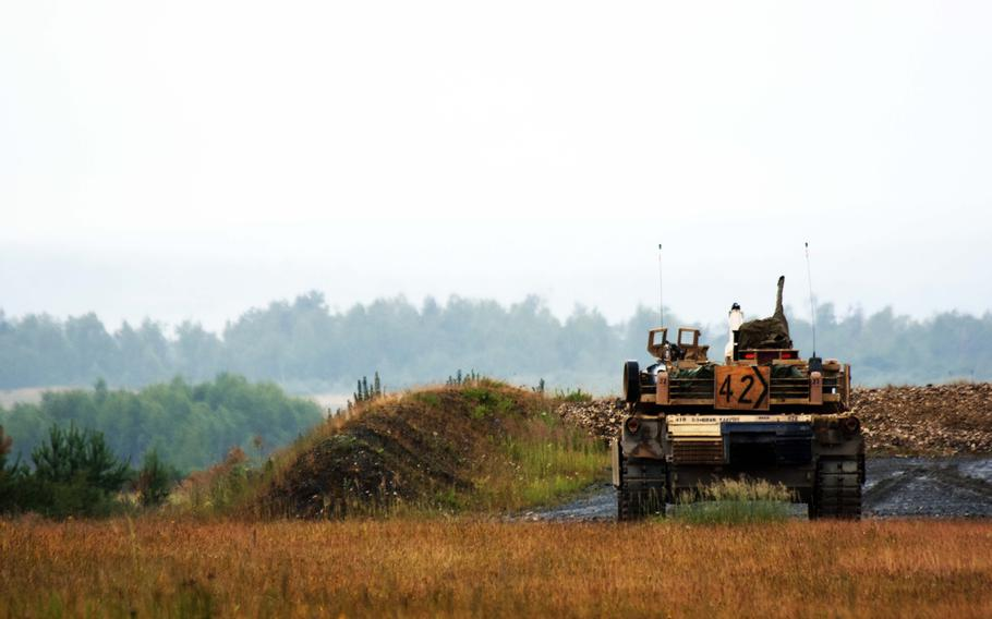 U.S. Army soldiers in an M1A1 tanks  move to engage a target during live-fire training at Grafenwoehr, Germany, Tuesday, June 27, 2017.
