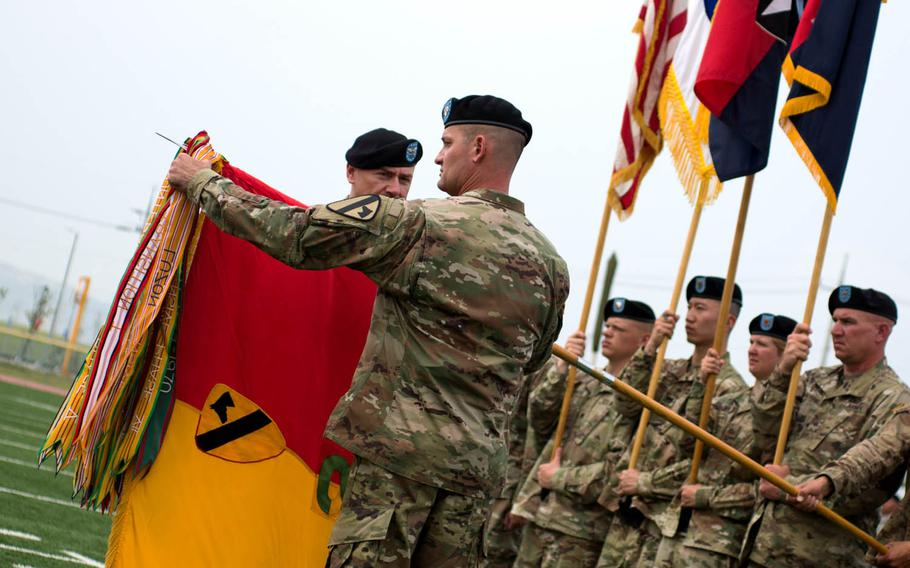 The 2nd Armored Brigade Combat Team, 1st Cavalry Division colors are uncased during a transfer-of-authority ceremony at Camp Humphreys, South Korea, Wednesday, June 28, 2017.