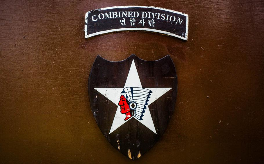The 2nd Infantry Division emblem on a flag stand at Camp Humphreys, South Korea, Wednesday, June 28, 2017.