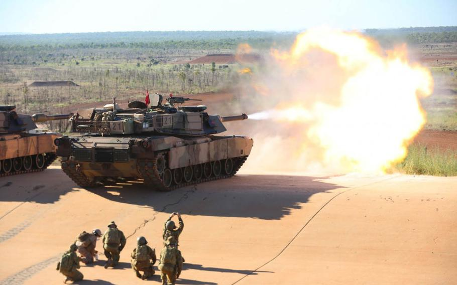 Marine Lance Cpl. Fernando Griego, a gunner with 1st Marine Division, Marine Rotational Force Darwin in Australia, remotely fires an M1A1 Abrams tank with an Australian armored regiment, May 6, 2017.