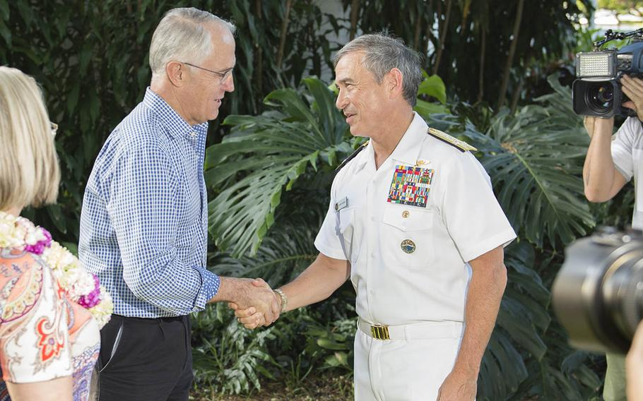Adm. Harry Harris, commander of U.S. Pacific Command, greets Australian Prime Minister Malcolm Turnbull last September in Hawaii.