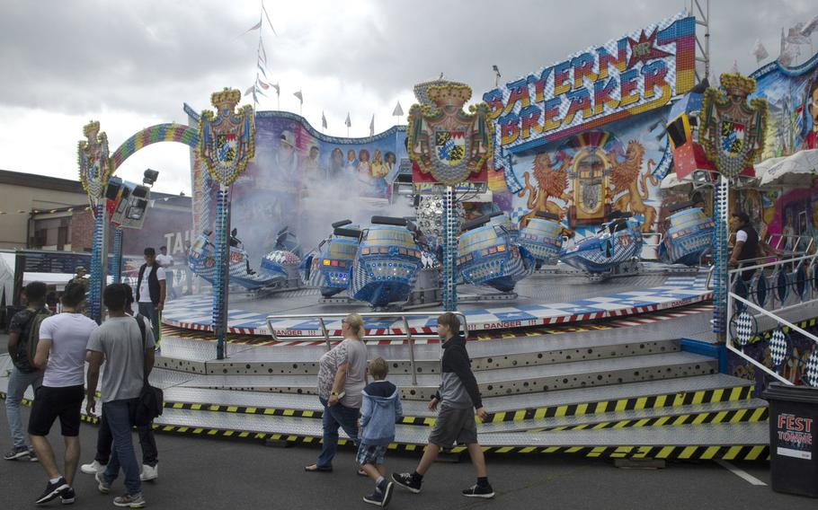 """Fest-goers at the Wiesbaden German-American Friendship Fest check out the """"Bayern Breaker"""" ride Thursday, June 29, 2017 in Wiesbaden, Germany.The fest, organized by U.S. Army Garrison Wiesbaden, is in its fourth year and open to Germans as well as Americans."""