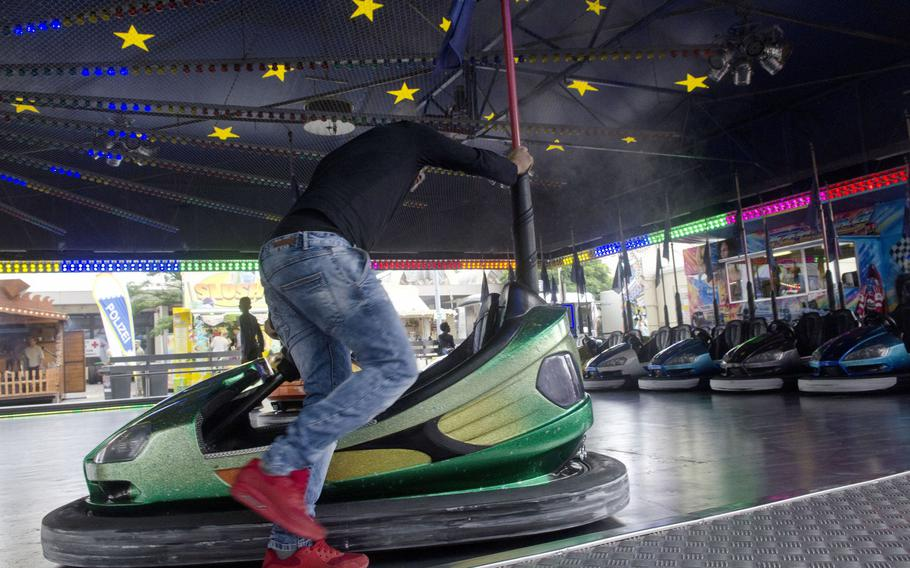 A festival worker puts a bumper car back in its starting position at the Wiesbaden German-American Friendship Fest Thursday, June 29, 2017 in Wiesbaden, Germany. Organized by U.S. Army Garrison Wiesbaden, this year's six-day fest should break last year's five-day total of approximately 125,000 visitors.