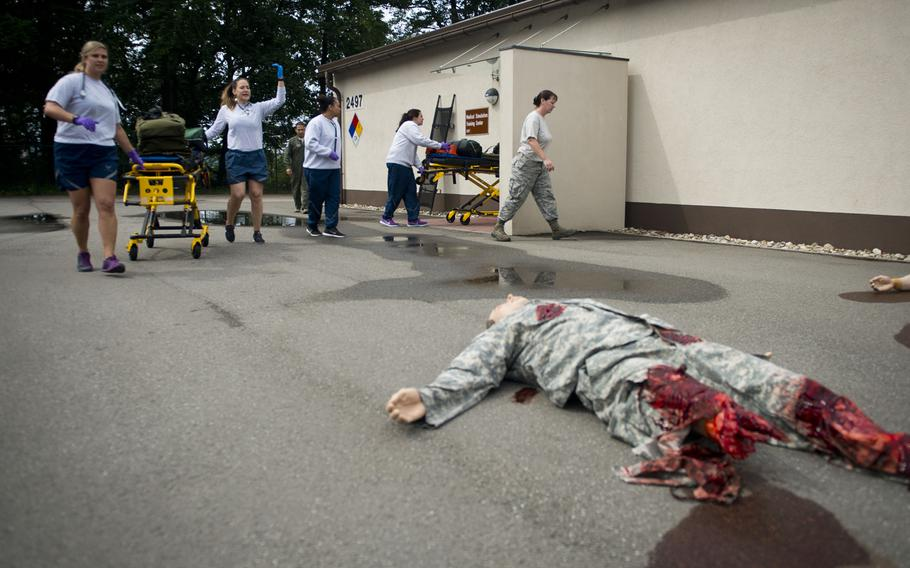 Airmen from the 86th Aeromedical Evacuation Squadron respond to simulated casualties during a mass casualty exercise at Ramstein Air Base, Germany, on Thursday, June 29, 2017. The exercise was part of a week-long recertification course that technicians complete every two years.