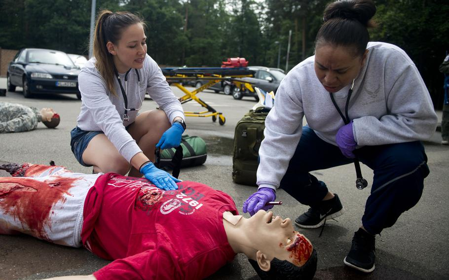 Master Sgt. Joanna Siavii, right, and Staff Sgt. Jozlinn Rae check a simulated casualty during a mass casualty exercise at Ramstein Air Base, Germany, on Thursday, June 29, 2017. Siavii and Rae are both from the 86th Aeromedical Evacuation Squadron.