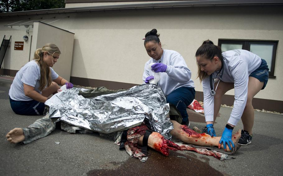 Staff Sgt. Chelsea Rittenhouse, left, Master Sgt. Joanna Siavii and Staff Sgt. Jozlinn Rae treat a simulated casualty during a mass casualty exercise at Ramstein Air Base, Germany, on Thursday, June 29, 2017.