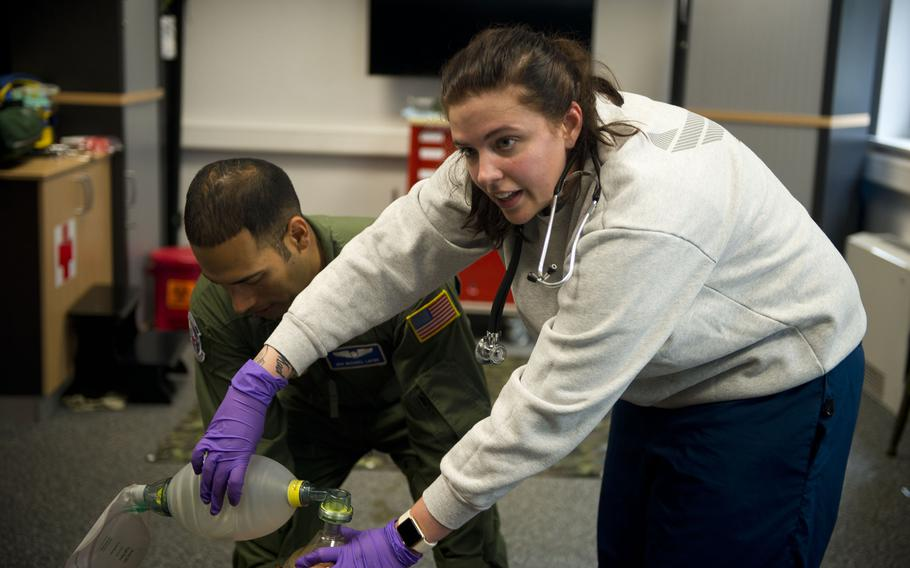 Senior Airman Rachel Aviles provides oxygen for a simulated casualty during an exercise at Ramstein Air Base, Germany, on Thursday, June 29, 2017.