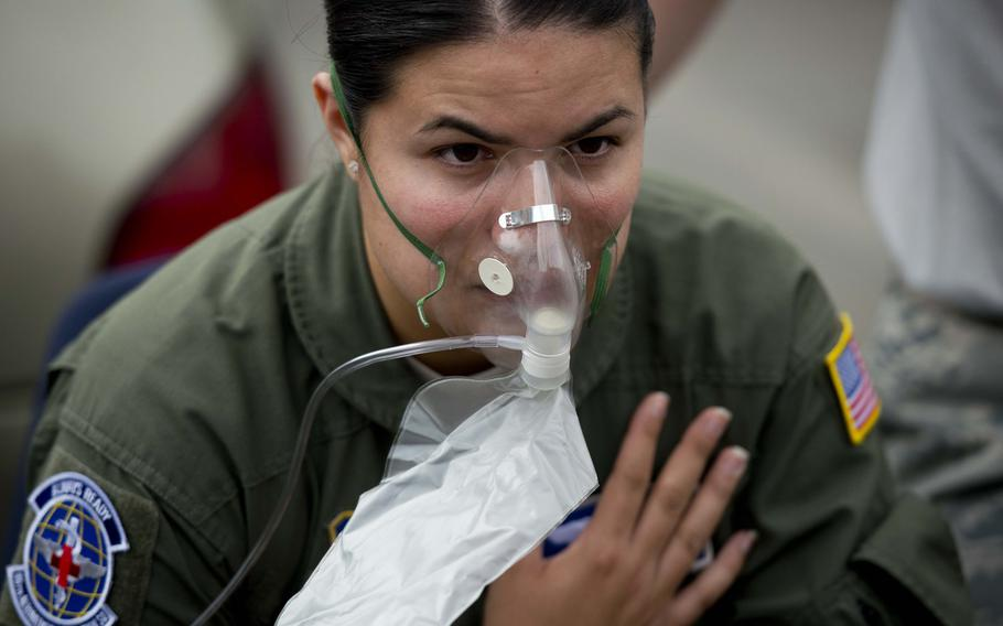 Senior Airman Jessica Hakert is treated for a simulated allergic reaction to a bee sting during a mass casualty exercise at Ramstein Air Base, Germany, on Thursday, June 29, 2017.