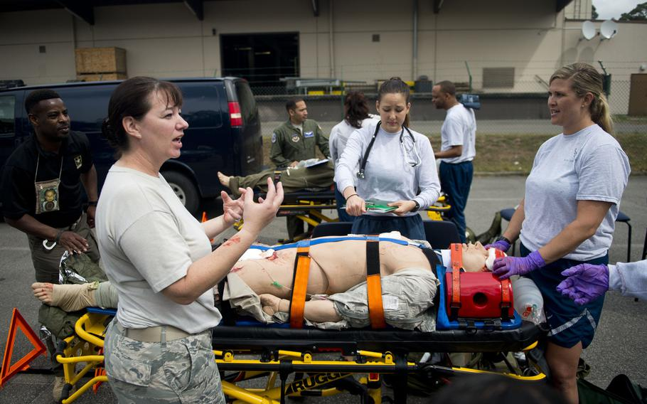 Master Sgt. Kimberly Taylor, left, gives feedback to Aeromedical Evacuation Technicians after an exercise at Ramstein Air Base, Germany, on Thursday, June 29, 2017. Taylor is an Emergency Medical Technician refresher course certifier from the 86th Medical Group.
