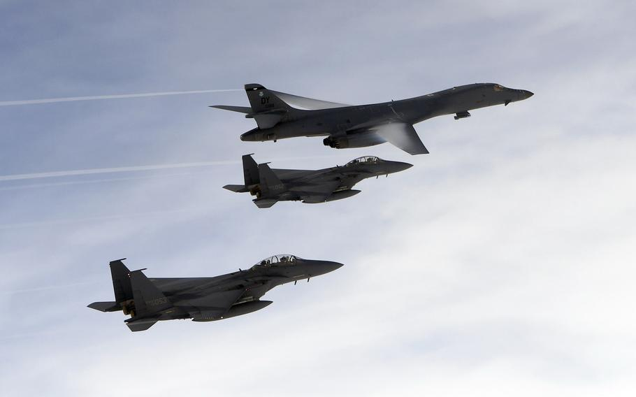 A U.S. Air Force B-1B Lancer assigned to the 9th Expeditionary Bomb Squadron, flies with South Korean F-15 fighter jets over the Korean Peninsula, on Friday, July 7, 2017. The mission was in response to a series of increasingly escalatory actions by North Korea, including a launch of an intercontinental ballistic missile on July 3.