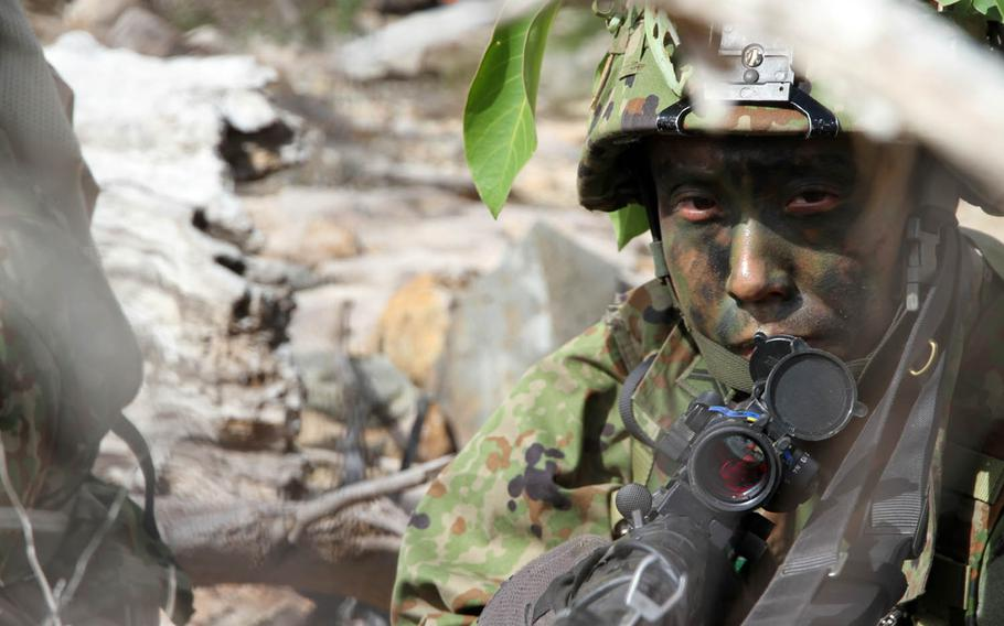 A Japan Ground Self-Defense Force paratrooper from the 1st Airborne Brigade, 3rd Battalion takes position during Talisman Saber drills at Shoalwater Bay Training Area, Australia, Friday, July 14, 2017.