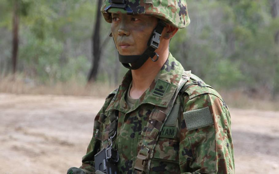 Maj. Yohei Hatayama, a Japan Ground Self-Defense Force company commander with Japan's elite 1st Airborne Brigade, 3rd Battalion, emerges from the Australian bush during Talisman Saber drills at Shoalwater Bay Training Area, Friday, July 14, 2017.