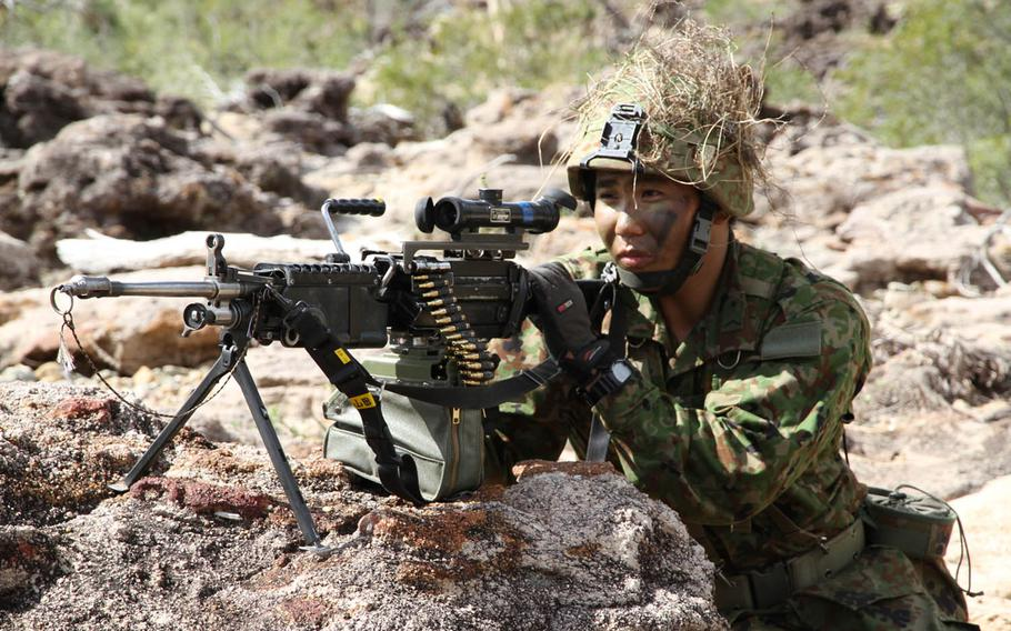 A Japan Ground Self-Defense Force paratrooper from the 1st Airborne Brigade, 3rd Battalion readies his machine gun during Talisman Saber drills at Shoalwater Bay Training Area, Australia, Friday, July 14, 2017.