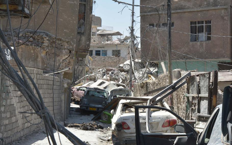 Dead bodies lie in the narrow streets near the ruins of the Great Mosque of al-Nuri in Mosul's Old City on Thursday, July 20, 2017.