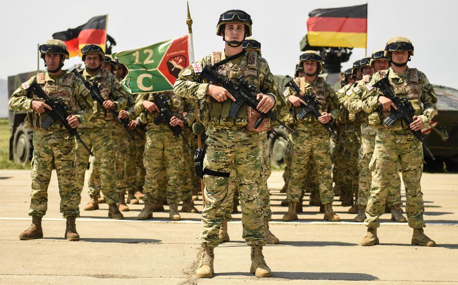 Georgian soldiers stand in formation during the opening ceremony of Noble Partner exercise at Vaziani, Georgia, July 29, 2017.  Noble Partner 17 is a European Rotational Force exercise of Georgia's light infantry company contribution to the NATO Response Force.