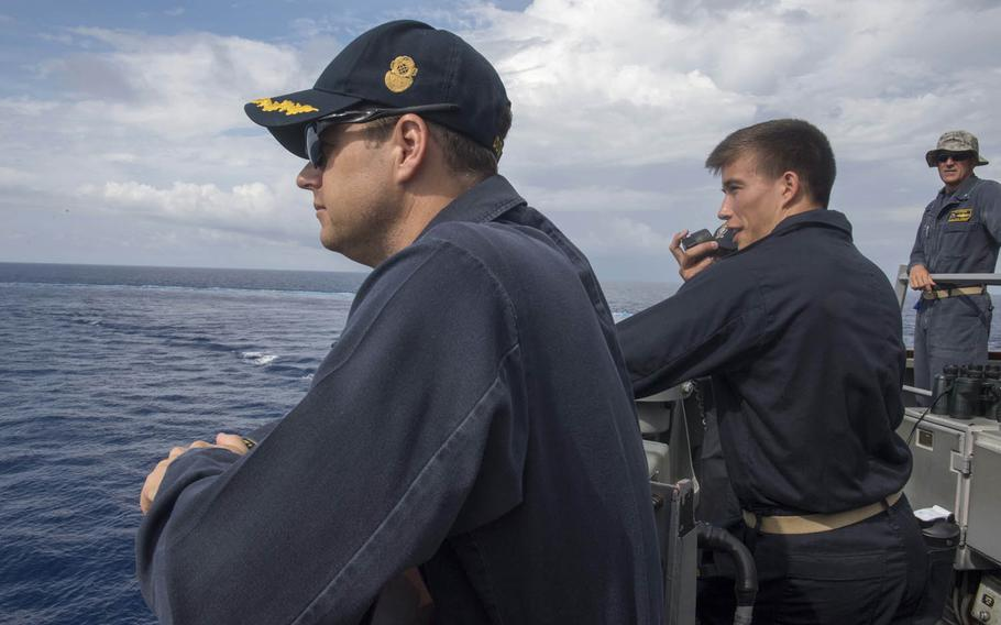 Sailors aboard the guided-missile destroyer USS Stethem take part in man-overboard training in the South China Sea, July 10, 2017.