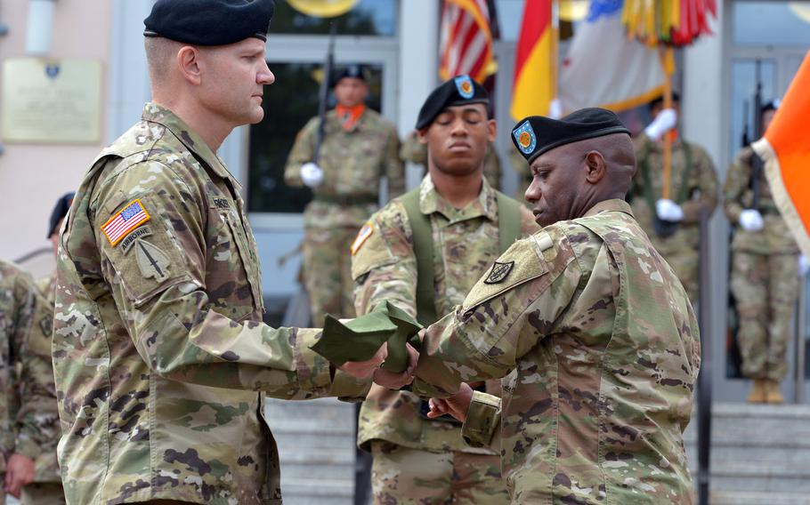 Col. Rob Parker, left, the 5th Signal Command's last commander, and  2nd Signal Brigade Command Sgt. Maj. Gregory Rowland case 5th Signal's colors at the unit's inactivation ceremony at Clay Kaserne in Wiesbaden, Germany, Friday, Aug. 4, 2017.