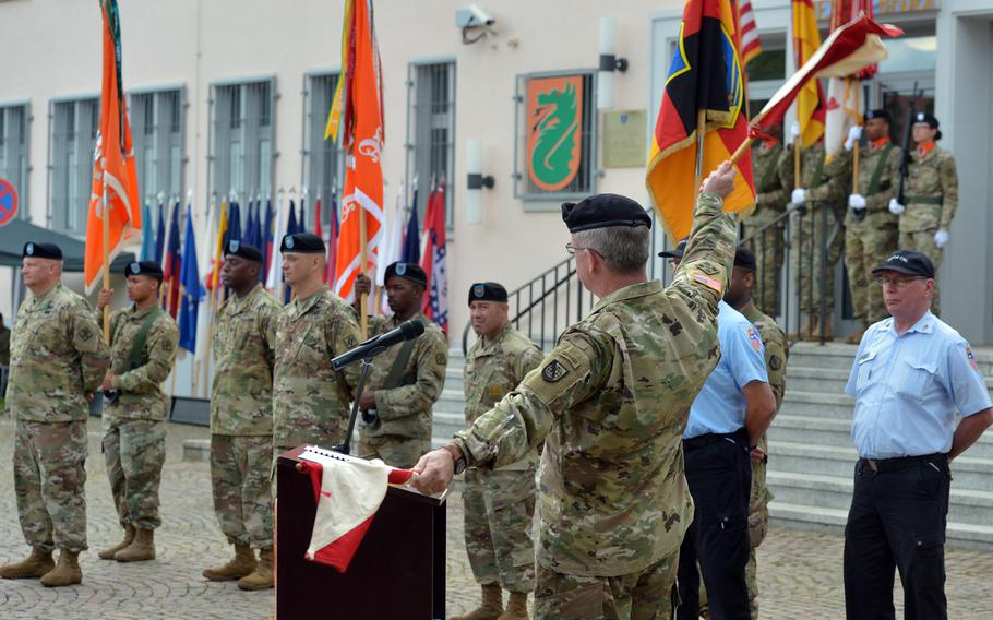 Maj. Gen. John Baker, commander of U.S. Army Network Enterprise Technology Command, uses old-fashioned signal flags during his speech at the 5th Signal Command's inactivation ceremony at Clay Kaserne in Wiesbaden, Germany, Friday, Aug. 4, 2017.