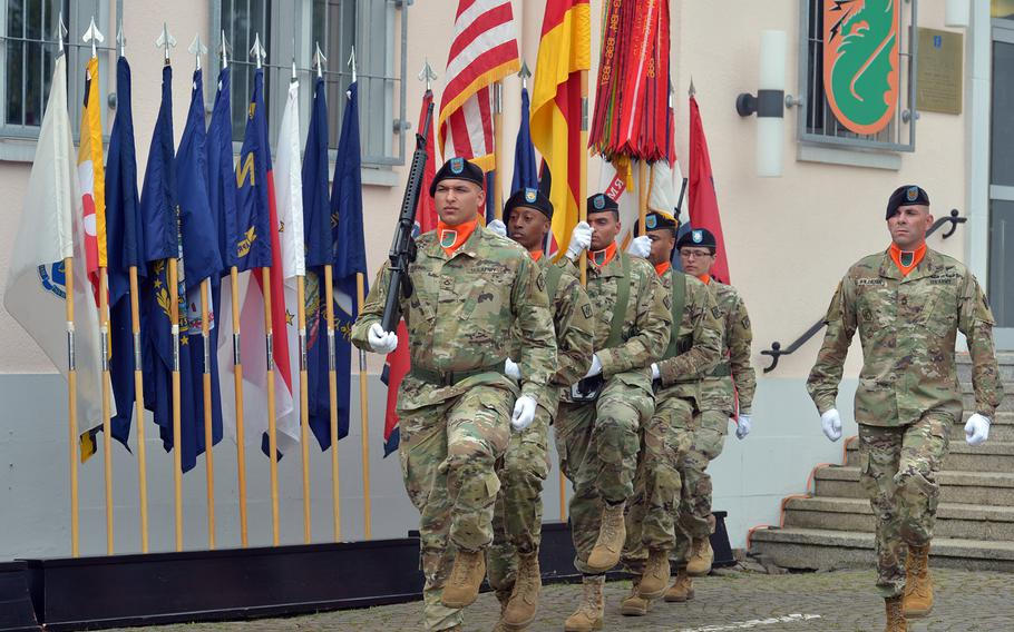 The color guard marches off the grounds at the conclusion of the 5th Signal Command's inactivation ceremony at Clay Kaserne in Wiesbaden, Germany, Friday, Aug. 4, 2017.