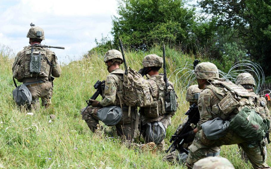 Soldiers with the Army's 1st Battalion, 68th Armored Regiment prepare to attack a mock urban environment during a live fire exercise in Grafenwoehr, Germany, Friday, Aug. 4, 2017.