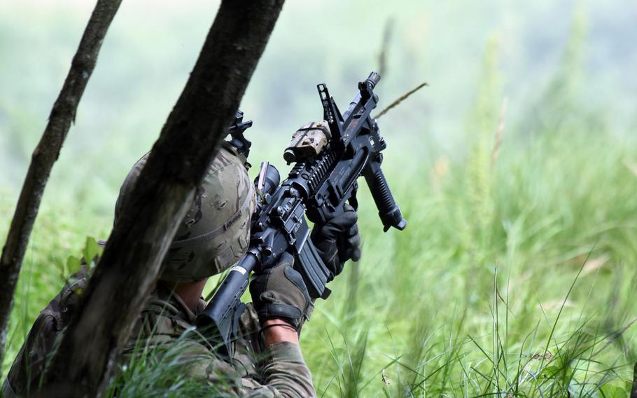 A soldier with the Army's 1st Battalion, 68th Armored Regiment, takes aim during a live fire exercise in Grafenwoehr, Germany, Friday, Aug. 4, 2017.
