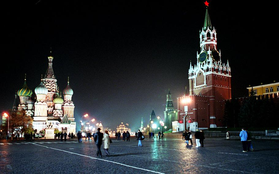 Tourists and residents stroll across Moscow's Red Square, with St. Basil's Cathedral on the left and the Kremlin with the Spassky tower at right. U.S. servicemembers and their families are experiencing increased levels of ''scrutiny and harassment'' while traveling to Russia, prompting an advisory to  avoid unofficial visits to the country.