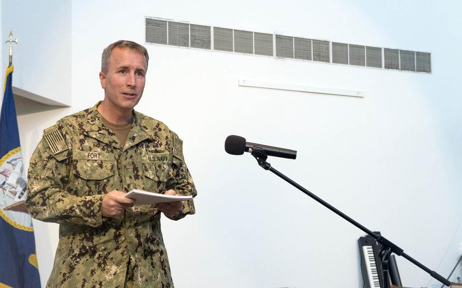 Rear Adm. Brian Fort reads his orders as he assumes command of Navy Region Hawaii and Naval Surface Group Middle Pacific at Joint Base Pearl Harbor-Hickam, Hawaii, Wednesday. Aug. 9. 2017.