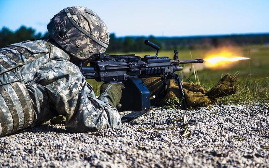 A Michigan National Guard soldier fires the M249 Squad Automatic Weapon during an exercise in Northern Michigan on Aug. 7, 2017. The Army wants a next-generation system that would replace the M249 and other weapons.