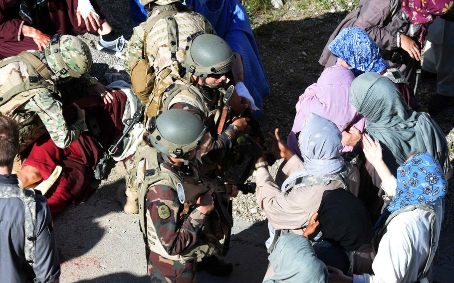 Hungarian soldiers act as the Afghan National Army in a role-playing exercise in Hohenfels, Germany on Tuesday, Aug. 15, 2017. They practice crowd control while American and Georgian troops conduct a medical evacuation.
