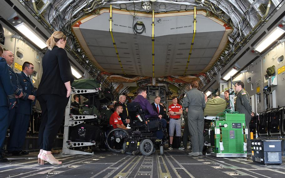 U.S. Air Force medical evacuation crew members describe their jobs from inside a C-17 at Ramstein Air Base, Germany, on Tuesday, August 15, 2017. Among those listening were two Canadians injured during combat in Afghanistan: Chris Klodt, a former Canadian Forces corporal who's now a paraplegic, and Maj. Simon Mailloux, who was able to return to duty with help of a prosthetic after losing his left leg in a roadside bomb.  Both plan to compete in the upcoming 2017 Invictus Games in Toronto.