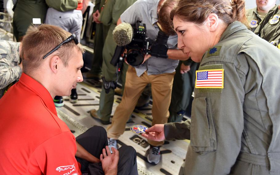 Lt. Col. Renee Matos presents an aeromedical military patch to Chris Klodt on Tuesday, Aug. 15, 2017, at Ramstein Air Base, Germany. Klodt, a former corporal with Canadian Forces, was injured in Afghanistan in 2006. The U.S. Air Force medically evacuated him to Germany, where he received care at Landstuhl Regional Medical Center. He returned to Germany to help mark the journey of the Invictus Spirit Flame as it travels from Afghanistan to Canada for the upcoming Invictus Games in Toronto next month.