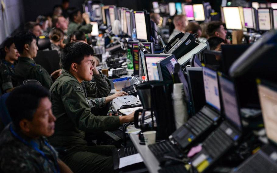 Members from the U.S. and South Korean militaries man the Hardened Theater Air Control Center at Osan Air Base, South Korea, during Ulchi Freedom Guardian drills in 2015. Portions of the image were blurred for security concerns.