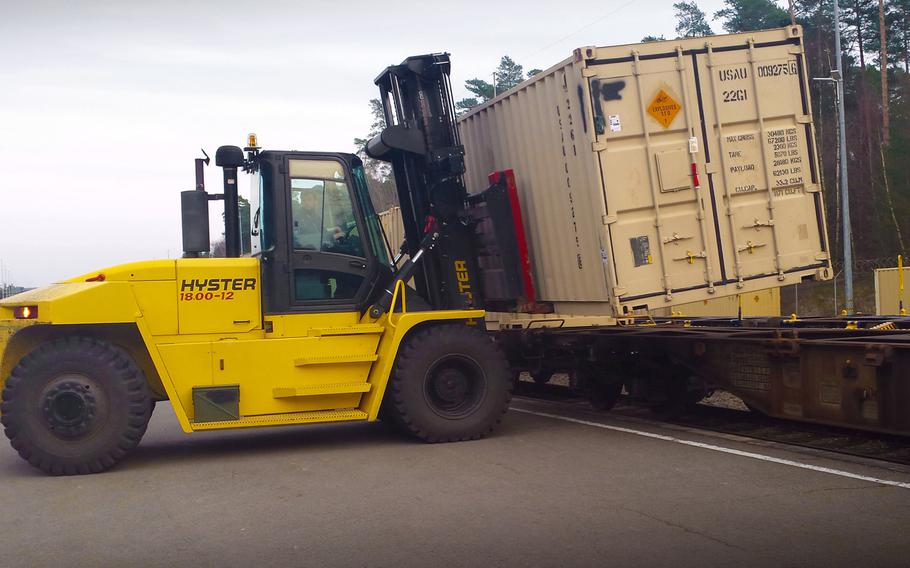 A heavy equipment operator with the Theater Logistics Support Center-Europe's ammunition center uses a forklift to offload cargo containers of ammunition from a train at Miesau Depot, in Germany in 2016.